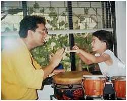 Taufiq passing on finer points on percussions  to Shikhar Naad